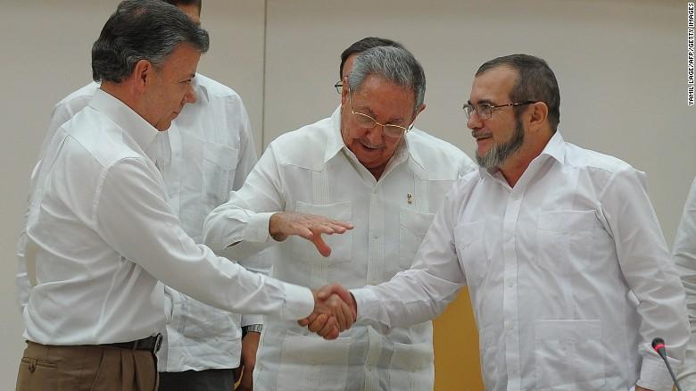 Colombian President Juan Manuel Santos, left, and FARC leader Timoleon Jimenez, right, in Havana.