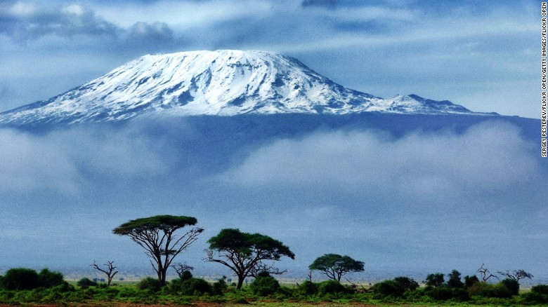 "At 19,340 feet, Kilimanjaro is Africa's highest peak, but the climb to the top is surprisingly accessible and can take as little as 4-5 days on the so-called ""fast route."" In fact, the fastest ever summit was achieved by Italian Bruno Brunod, who managed to reach the peak in 5 hours 38 minutes.<br /><br />The journey to the top from the steppes below takes in all manner of ecosystems, stretching from agrarian landscapes to rainforest, heath to alpine desert before arctic conditions at the summit. At the top of the mountain lies a simple wooden box in which climbers can record their thoughts."