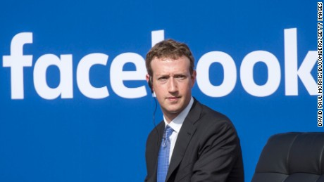 """Mark Zuckerberg, chief executive officer of Facebook Inc., listens as Narendra Modi, India's prime minister, not pictured, speaks during a town hall meeting at Facebook headquarters in Menlo Park, California, U.S., on Sunday, Sept. 27, 2015. Prime Minister Modi plans on connecting 600,000 villages across India using fiber optic cable as part of his """"dream"""" to expand the world's largest democracy's economy to $20 trillion. Photographer: David Paul Morris/Bloomberg via Getty Images"""