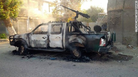 A burnt-out police pick-up truck stands in the street after Afghan security forces retook control of Kunduz city from the Taliban militants in northeastern Kunduz province, on October 1, 2015.  Afghan forces retook control of the strategic northern city of Kunduz on October 1 after a three-day Taliban occupation that dealt a stinging blow to the country's NATO-trained military.    AFP PHOTO        (Photo credit should read STR/AFP/Getty Images)