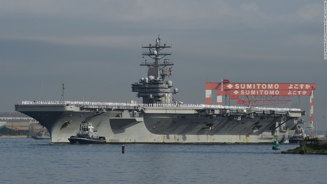 "The Nimitz-class aircraft carrier USS Ronald Reagan (CVN 76) arrives at the U.S. Navy base in Yokosuka, a suburb of Tokyo, Japan, on October 1, 2015. The Reagan is the fifth U.S. carrier forward deployed to Japan following USS George Washington (CVN 73), USS Kitty Hawk (CV 63), USS Independence (CV 62) and USS Midway (CV 41), according to the Navy. About two-thirds of the Reagan's crew is from the George Washington, having participated in <a href=""http://www.cnn.com/2015/03/04/us/us-navy-three-presidents/"">a ""hull swap,"" </a>an exchange of crews between ships, earlier this year. Click through the gallery to see other U.S. aircraft carriers."