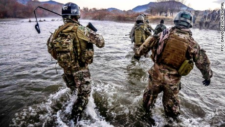 U.S. Special Forces cross a wide river during a clearance operation in Gaza Valley, Arghandab district, Zabul province, Afghanistan, Dec. 11, 2013.