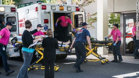A patient is wheeled into the emergency room at Mercy Medical Center in Roseburg, Ore., following a deadly shooting at Umpqua Community College, in Roseburg, Thursday, Oct. 1, 2015. (Aaron Yost/Roseburg News-Review via AP)