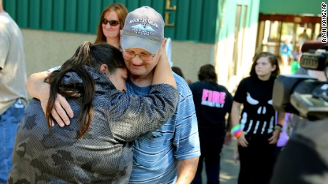 Friends and family are reunited with students at the county fairgrounds after a deadly shooting at Umpqua Community College in Roseburg, Oregon, on Thursday, October 1.