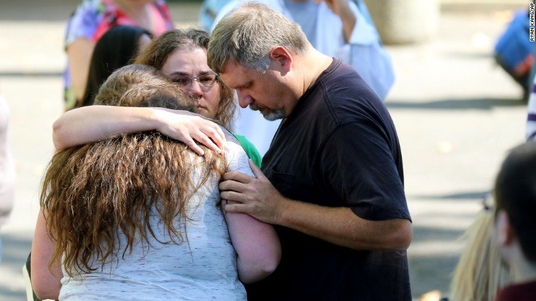 Students are reunited with friends and family after a deadly shooting at Umpqua Community College in Roseburg, Oregon, on Thursday, October 1. Preliminary information indicated that 10 people were killed and more than 20 were injured, police said. Douglas County Sheriff John Hanlin announced in a news conference that the shooter is dead.