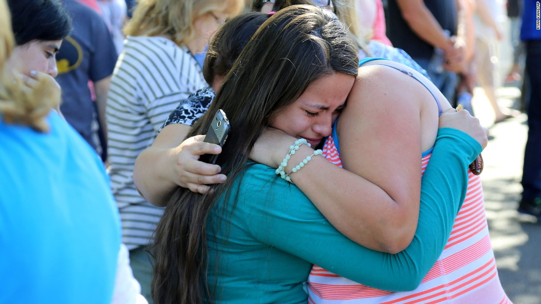A woman is comforted after the deadly shooting at Umpqua Community College in Roseburg, Oregon, on October 1. Douglas County Sheriff John Hanlin announced at a news conference that the shooter was dead.