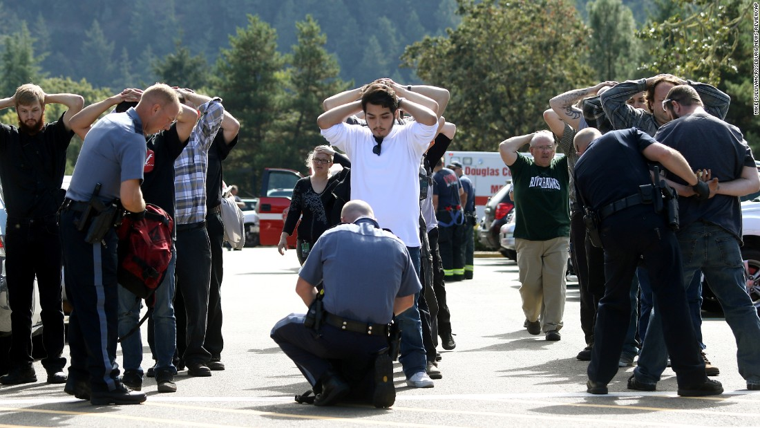 "Police search students outside Umpqua Community College on Thursday, October 1, after <a href=""http://www.cnn.com/2015/10/01/us/gallery/oregon-shooting-umpqua-community-college/index.html"" target=""_blank"">a deadly shooting at Umpqua Community College</a> in Roseburg, Oregon. Nine people were killed and at least 9 were injured, police said. The gunman, Chris Harper-Mercer, apparently committed suicide after exchanging gunfire with officers, a sheriff said."