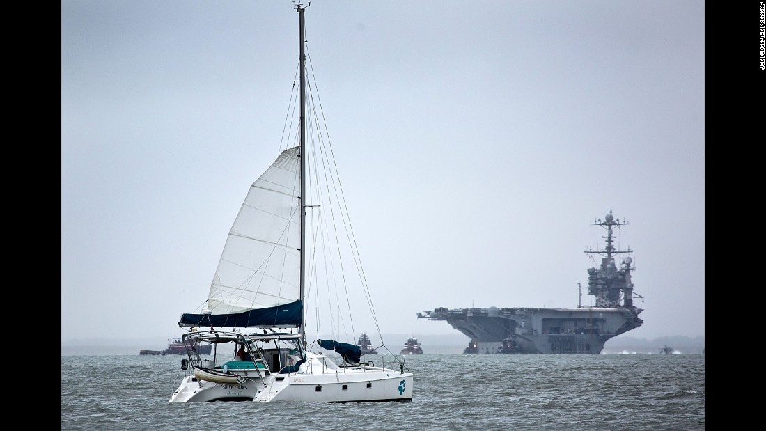 A catamaran sails off the coast of Virginia as the USS Harry S. Truman returns to port on October 1.