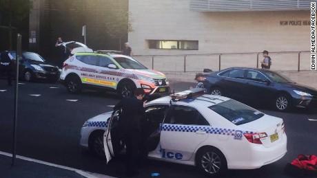 Civilian police worker, gunman killed in Australia shooting...