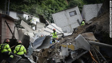 Rescuers search for victims after a landslide hit El Cambray, Guatemala.