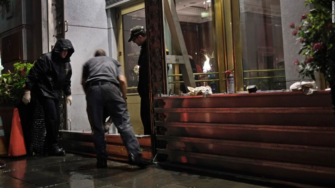 Workers install a flood barrier at the entrance to the Market Pavilion Hotel in downtown Charleston, South Carolina, on Friday, October 2. Parts of the South Carolina coast braced for likely flooding with more than 15 inches.