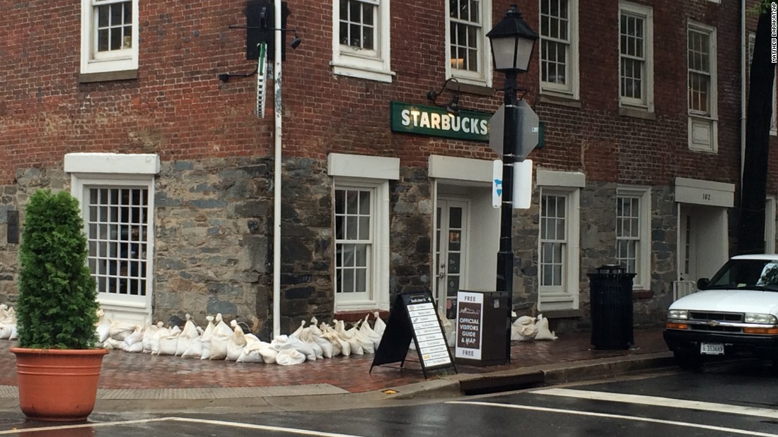 Sandbags surround a building in Old Town Alexandria, Virginia.