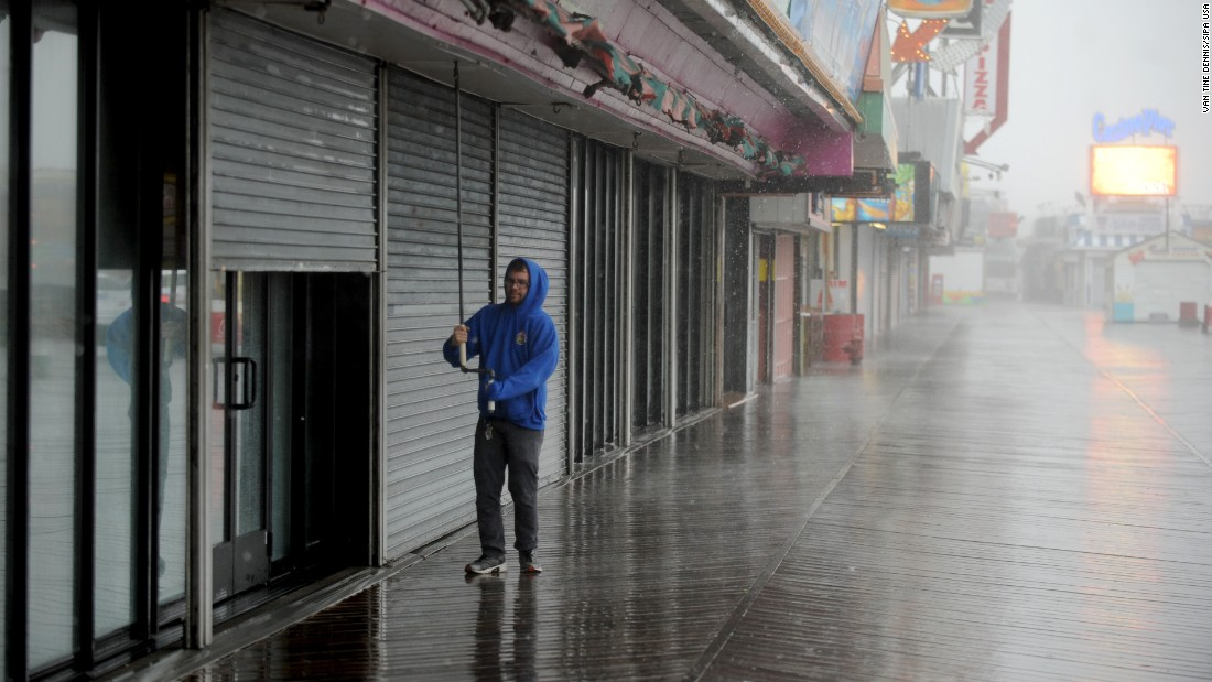 A man closes a storefront on October 2 in Seaside Heights, New Jersey.