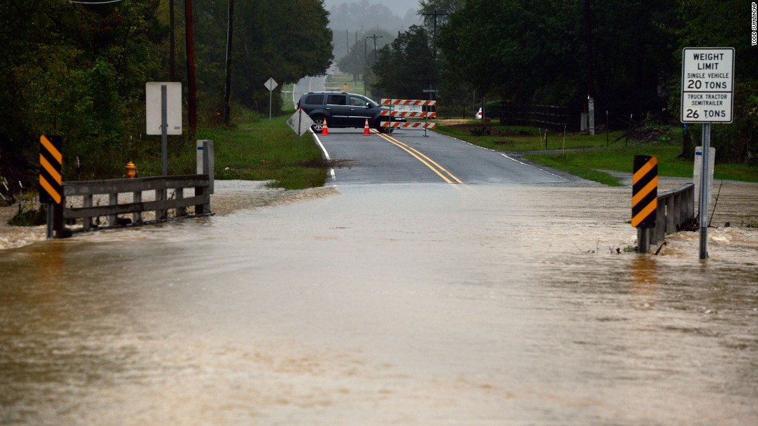 A motorist turns back as floodwater rises in Harrisburg, North Carolina, on October 3.