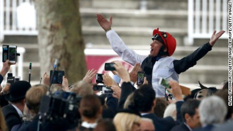 The 44-year-old Dettori savors his fourth victory in Europe's most prestigious horse race.