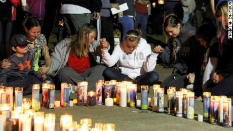 Residents of Roseburg gather at a candlelight vigil for the victims of the shooting in Roseburg, Oregon.
