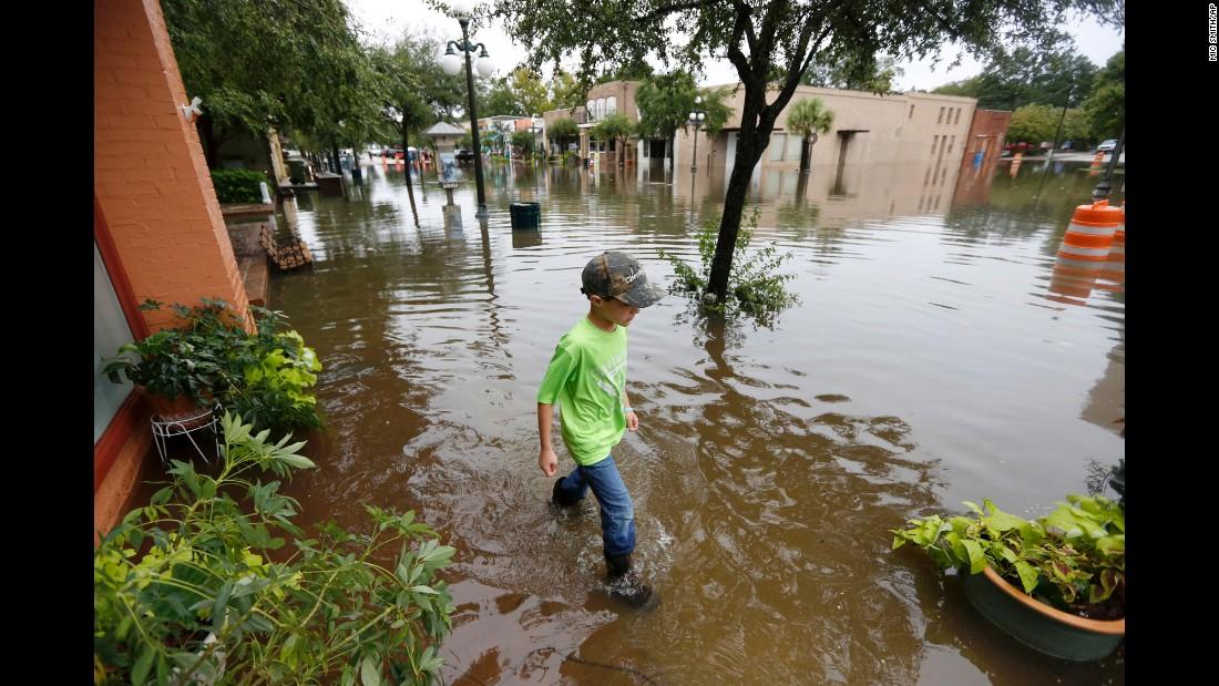Tripp Adams, 8, walks through flood waters in Georgetown, South Carolina, on October 4.