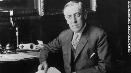circa 1915:  Portrait of U.S. president Woodrow Wilson (1856-1924) sitting at a desk, holding a letter.  (Photo by Hulton Archive/Getty Images)