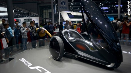 Visitors look at a Toyota FV2 at the 16th Shanghai International Automobile Industry Exhibition in Shanghai on April 22, 2015. Chinese technology giants Alibaba and Tencent are promising to build the cars of the future, vehicles linked seamlessly to the Internet and offering shopping and navigation help while on the road.     AFP PHOTO/ WANG ZHAO        (Photo credit should read WANG ZHAO/AFP/Getty Images)