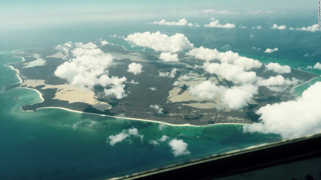 The HC-130 passes back over San Salvador Island, Bahamas, on its way back to the base in Clearwater, Florida. The starting point for the more than 1,000-square-mile search Monday was just northeast of San Salvador Island, in the Atlantic Ocean. The Coast Guard announced while this plane was airborne that the search for the actual container ship was over and the focus was now solely on survivors.