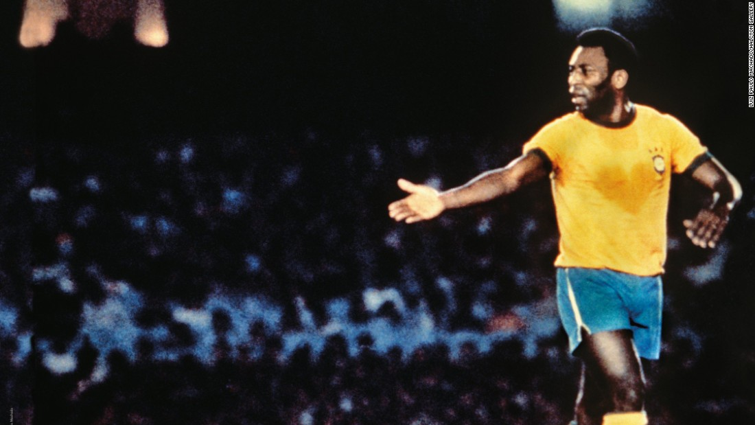 """Luiz Paulo Machado's famous photograph was taken during a friendly match in October 1976 where a heart appears on Pele's bright yellow Brazil shirt. It earned the title """"The Heart of the King."""" Pele won three World Cup titles with his country, in 1958, 1962 and 1970."""