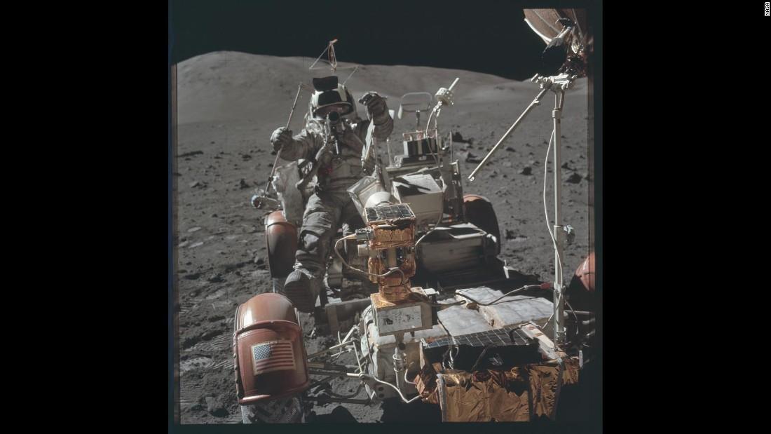An astronaut rides on a lunar module during Apollo 17.