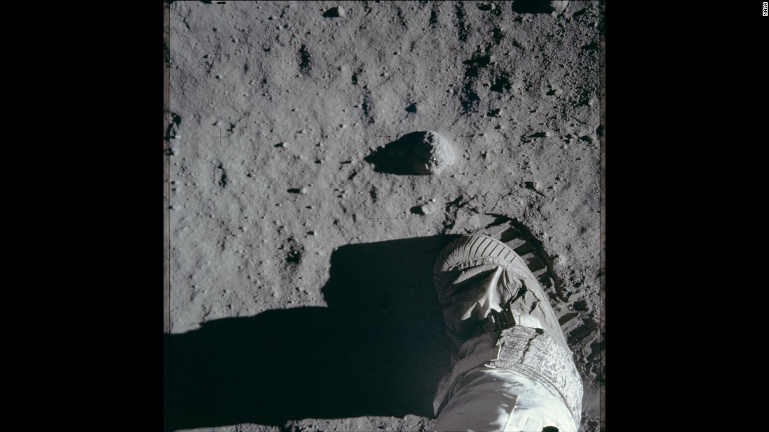 A close-up view of an astronaut's boot on the moon's surface during Apollo 11.