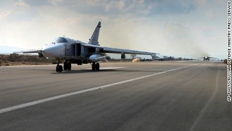 A Russian SU-24M jet fighter takes off from an airbase in Hmeimim, Syria, on October 6, 2015.
