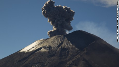 View of the Popocatepetl volcano --the most active of Mexico-- spewing ash seen from the Altzomoni mountain, Mexico On October 29, 2014. AFP PHOTO/Hector Guerrero        (Photo credit should read HECTOR GUERRERO/AFP/Getty Images)