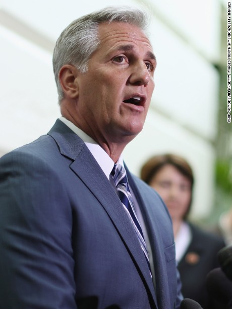 WASHINGTON, DC - JULY 09:  House majority leader-elect Rep. Kevin McCarthy (R-CA) (C) talks with reporters after the weekly House Republican caucus meeting at the U.S. Capitol July 9, 2014 in Washington, DC. The House GOP leadership blamed Senate Democrats for holding up legislation that would create more full-time jobs, they said.  (Photo by Chip Somodevilla/Getty Images)
