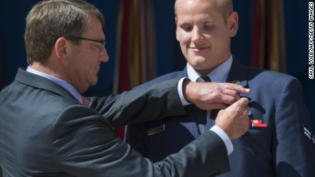 Airman 1st Class Spencer Stone, right, receives the Airman's Medal from Defense Secretary Ashton Carter in Washington on September 17 for his role in disarming a gunman on a Paris-bound train in August.