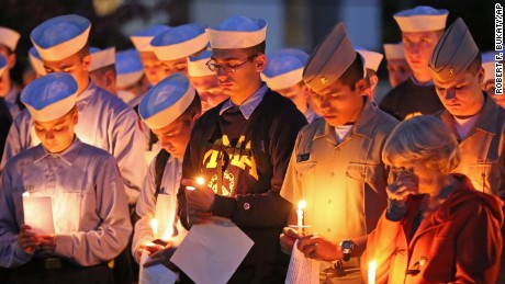 Maine Maritime Academy students bow their heads during a vigil of hope for the missing crew members of the U.S. container ship El Faro, Tuesday evening, Oct. 6, 2015, in Castine, Maine. The Coast Guard has concluded the vessel sank near the Bahamas during Hurricane Joaquin. Four graduates of Maine Maritime Academy  are missing. They are Capt. Michael Davidson of Windham, Maine, Michael Holland, 25, of Wilton, Maine,  Danielle Randolph, 34, of Rockland, Maine, and Dylan Meklin, also of Rockland. (AP Photo/Robert F. Bukaty)