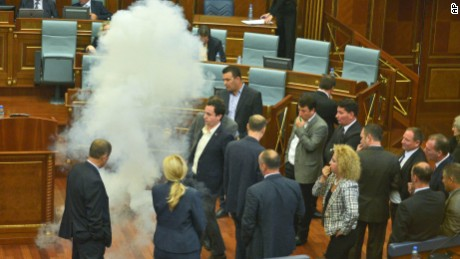 Opposition lawmakers in Kosovo disrupt Parliament's session using tear gas and whistles, in capital Pristina on Thursday, Oct. 8, 2015,. The opposition protested over the government's recent EU-sponsored deal with Serbia giving the country's Serb-majority areas greater powers. (AP Photo)