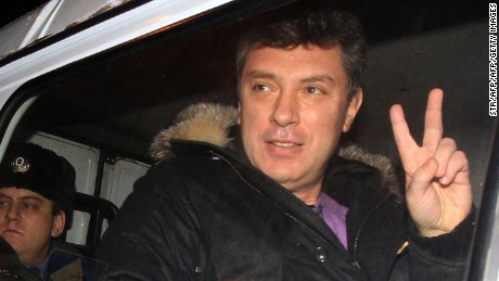 "Former deputy prime minister turned opposition leader Boris Nemtsov sits in a police vehicle as he unexpectedly leaves a jail in Moscow, on January 15, 2011, shortly before the time of Nemtsovs official release from detention. Nemtsov was arrested after an anti-Kremlin rally on Moscow's Triumfalnaya Square on New Year's Eve and sentenced to 15 days in jail for ""disobeying police instructions.""  AFP PHOTO (Photo credit should read STR/AFP/Getty Images)"