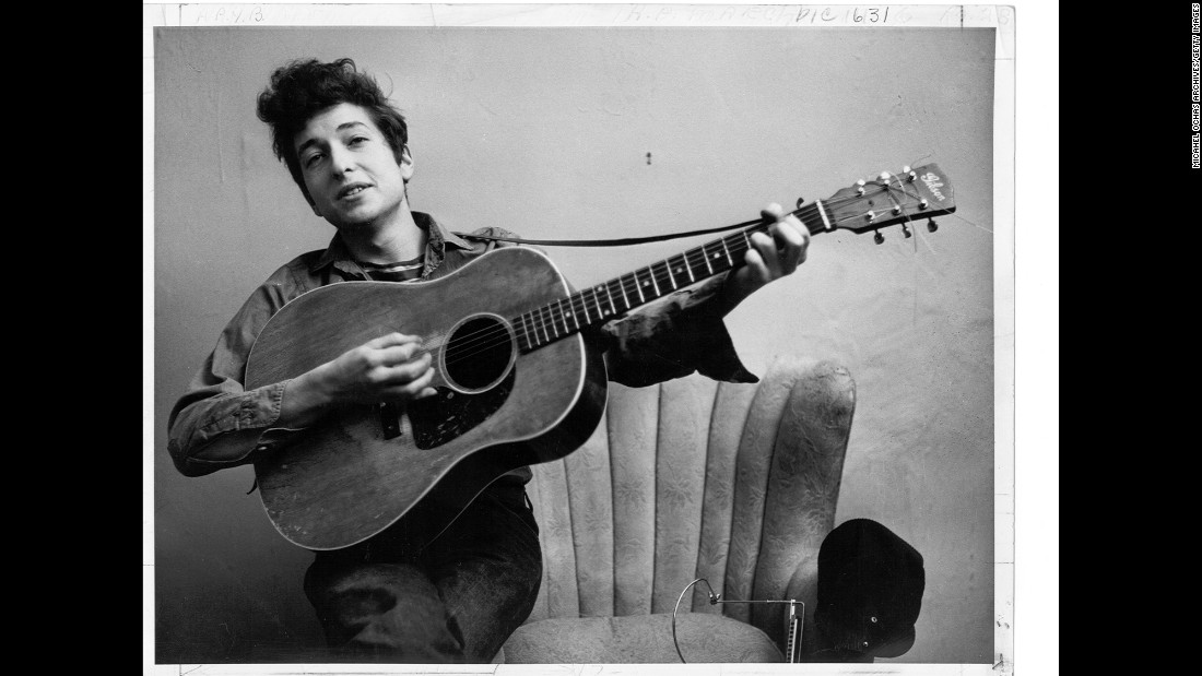 Today Bob Dylan is one of the most renowned figures in pop-music history -- a groundbreaking songwriter, a much-honored talent, an inscrutable persona. But in 1961 he was just a 19-year-old kid from Minnesota scrambling to make a living in New York's folk clubs. In September 1961, he posed for a portrait with his Gibson acoustic guitar -- around the time that Columbia Records scout John Hammond first met him at a rehearsal. Hammond signed Dylan at the end of September. Dylan's first album was six months away.