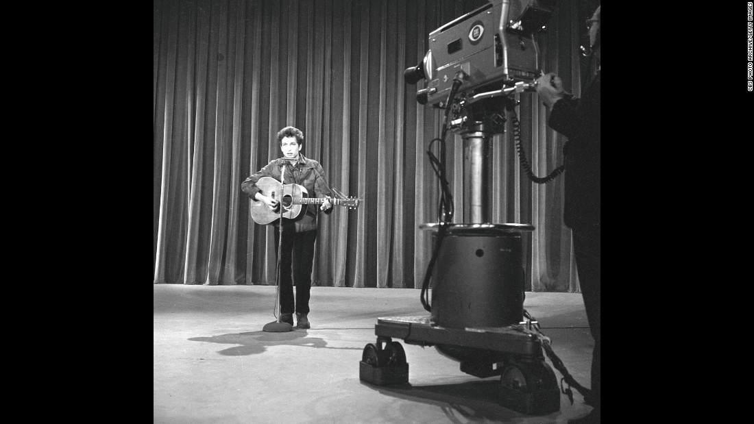 """In 1963, Dylan got the call performers dreamed about: an appearance on """"The Ed Sullivan Show,"""" one of the most popular TV shows in the country. (A year later, <a href=""""http://www.cnn.com/2014/01/30/showbiz/celebrity-news-gossip/beatles-ed-sullivan-50-years-anniversary/"""">Sullivan would introduce the Beatles.)</a> At rehearsals, shown here, Dylan performed """"Talkin' John Birch Paranoid Blues."""" But some CBS brass, <a href=""""http://query.nytimes.com/mem/archive-free/pdf?res=9A06E5D8133CE63ABC4C52DFB3668388679EDE"""" target=""""_blank"""">worried about controversy</a> over the song's mockery of the right-wing John Birch Society, were nervous, and <a href=""""http://www.history.com/this-day-in-history/bob-dylan-walks-out-on-the-ed-sullivan-show"""" target=""""_blank"""">Dylan declined to perform something else.</a> He never did appear on """"Sullivan."""""""