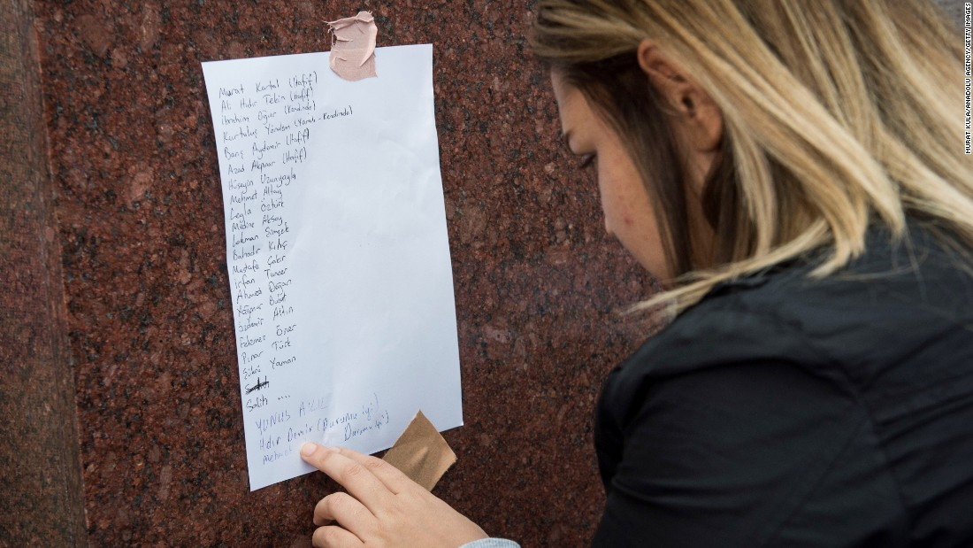 A woman looks at a list at the Ibn-i Sina hospital of people who were injured in the explosion.