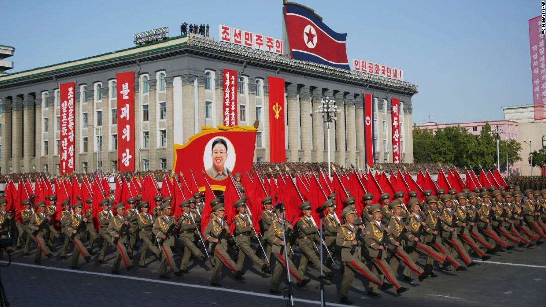 North Korean soldiers march beneath a portrait of late leader Kim Jong Il, Kim Jong Un's father, during the parade in Pyongyang.
