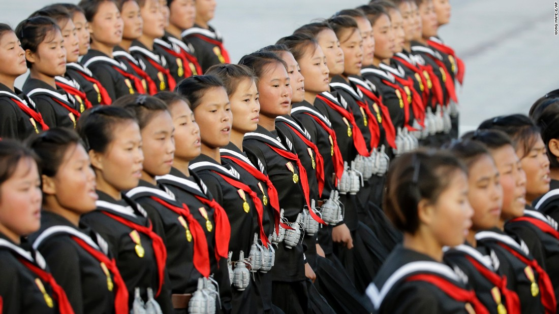 North Korean girls wear replica grenades as they march during the parade in Pyongyang.