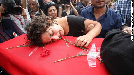 A relative mourns over the coffin of Korkmaz Tedik, a board member of the Turkish Labour Party (EMEP), who was killed in twin bombings in Ankara the day before during his funeral in the capital on October 11, 2015 . Turkey woke in mourning on October 11 after at least 95 people were killed by suspected suicide bombers at a peace rally of leftist and pro-Kurdish activists in Ankara, the deadliest such attack in the country's recent history. AFP PHOTO /ADEM ALTAN        (Photo credit should read ADEM ALTAN/AFP/Getty Images)