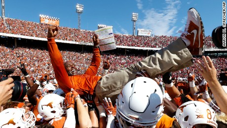 University of Texas Longhorns head coach Charlie Strong is carried by his players following an NCAA college football game against the University of Oklahoma Sooners at the Cotton Bowl on Saturday October 10, 2015 in Dallas, Texas. University of Texas won 24-17. (Aaron M. Sprecher via AP)