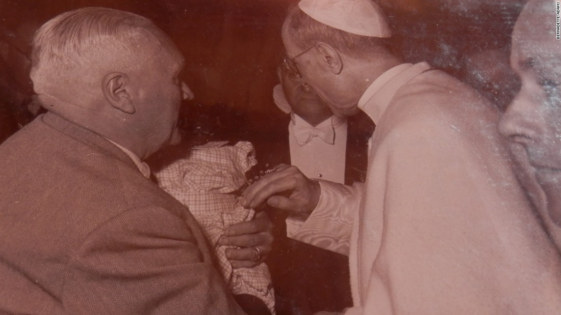 Hidden in the darkness, Jean-Pierre meets Pope Pius XII shortly after being taken to Europe by his grandmother from Senegal. The picture is from a scrapbook that Bernadette still holds.