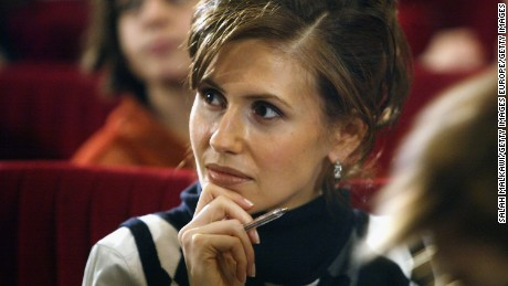 ALEPPO, SYRIA - FEBRUARY 9:  Asmaa al-Assad, wife of the Syrian President attends the first national childhood conference, February 9, 2004 in Aleppo in the north of Syria. In attending the gathering, the first lady is breaking with tradition for the wife of the president to take role in public life.  (Photo by Salah Malkawi/Getty Images)
