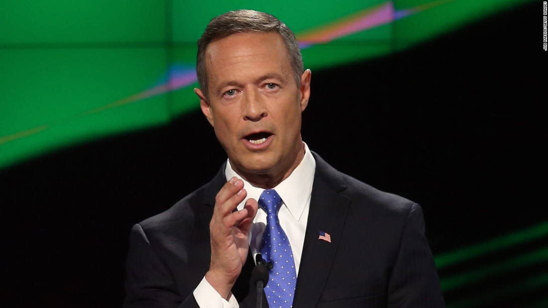 "O'Malley faces the camera while delivering remarks. He went after Sanders on gun control early in the debate, and -- in what could be interpreted as a veiled swipe at Clinton -- he said, ""I am very clear about my principles."""