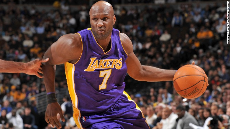 Lamar Odom dribbles the ball during an NBA game against the Denver Nuggets in November 2010. Odom, who won two championships during his career and later married reality TV star Khloe Kardashian, was hospitalized Tuesday, October 13, after he was found unconscious at a brothel in Nevada.