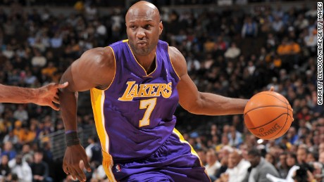 Lamar Odom dribbles the ball during a game against the Denver Nuggets in November 2010.