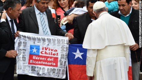Pope Francis meets a group of Chilean miners who were rescued from the 2010 mining accident, at the end of his weekly general audience at St Peter's square on October 14, 2015 at the Vatican. Pope Francis apologised on behalf of the Catholic Church for a series of scandals which have recently shaken the city of Rome and the Vatican. The Vatican has been the focus of several controversies including the coming out of a gay priest and the leak of a controversial letter, while the pontiff himself ended up in the headlines for a gaffe which helped oust Rome's mayor.  AFP PHOTO / VINCENZO PINTO        (Photo credit should read VINCENZO PINTO/AFP/Getty Images)