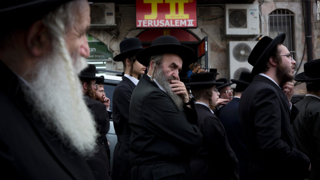 "Ultra-Orthodox Jewish men gather around the body of Yeshayahu Kirshavski during his funeral in Jerusalem on Tuesday, October 13. According to the Times of Israel, Kirshavski was killed by a Palestinian <a href=""http://www.timesofisrael.com/barkat-joins-thousands-at-funeral-of-jerusalem-attack-victim/"" target=""_blank"">in a car-ramming attack.</a>"