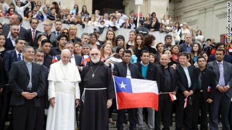 Pope Francis poses with some of the 33 Chilean miners who were rescued from the 2010 mining accident at the end of his weekly general audience in St. Peter's Square, at the Vatican, Wednesday, Oct. 14, 2015. (AP Photo/Gregorio Borgia)