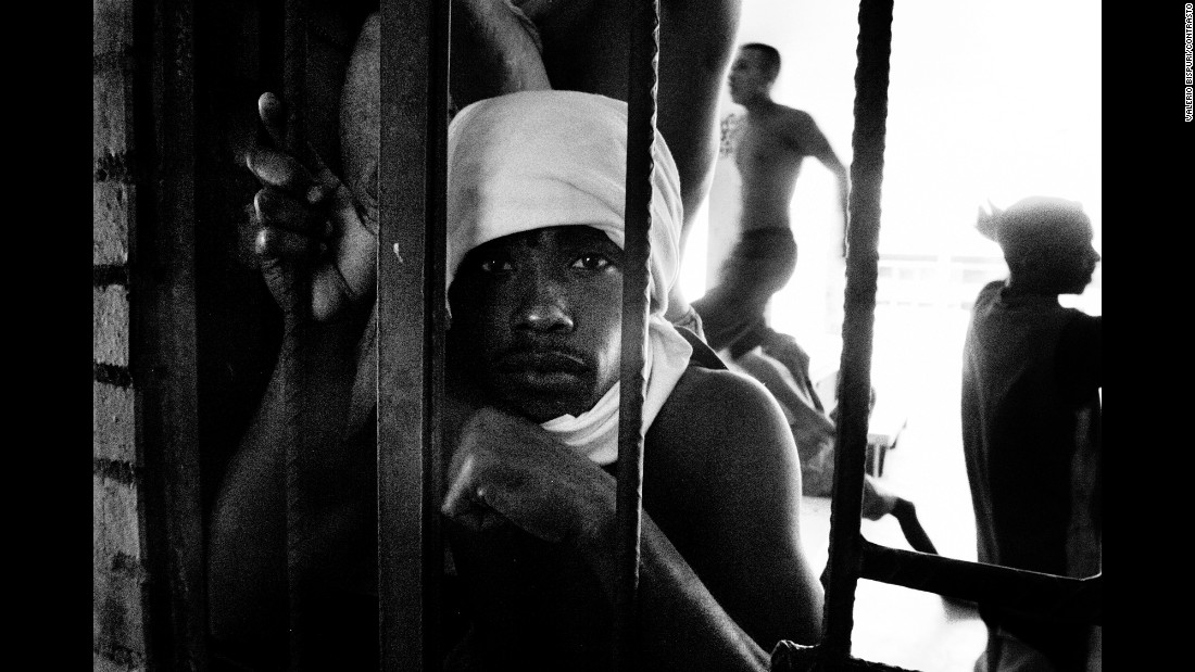 A prisoner in Medellin, Colombia, looks out from behind bars in 2007. Over 10 years, photographer Valerio Bispuri visited 74 prisons in South America. Bispuri said his mission was to humanize prisoners and help find a universal element that connects us all.